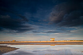 View at sweeping beach under dark clouds, St. Peter Ording, Eiderstedt peninsula, Schleswig Holstein, Germany, Europe
