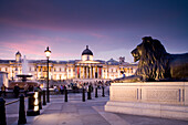Trafalgar Square with lion statue and National Gallery, London, England, Europe