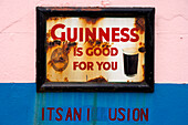 Old advertising sign for beer outside Dan Foley`s Pub in Annascaul, County Kerry, Ireland Europe