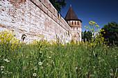 Red brick wall and tower of Borisogleb monastery, XVIIth century. Borisogleb. Yaroslavl region. Russia.