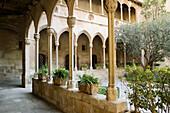 Old Gothic cloister (15th century) of Montserrat benedictine monastery. Barcelona province, Spain