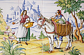 Mosaic of tiles depicting folk scenes in a cortijo (typical Andalusian farmhouse). Andalusia, Spain