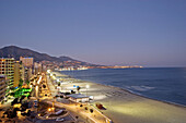 Beach front and promenade in the evening, Fuengirola. Málaga province, Costa del Sol. Andalusia, Spain
