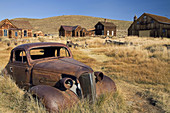 Old rusted car in the ghost town.  Bodie State Historic Park. Bodie. California. United States