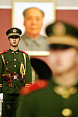 Chinese soldiers guard the Tiananmen Square with the Gate of Heavenly Peace in the background, Beijing, China