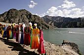 Uighur woman's dress for hire for souvenir photo shoots on the shore of Tian Chi Lake (Heavenly Lake), Urumchi, Xinjiang Province, China