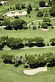 Aerial view, Aerial views, Color, Colour, Contemporary, Daytime, Exterior, Golf, Golf course, Golf courses, Green, Nature, Outdoor, Outdoors, Outside, Sport, Sports, Tree, Trees, Vegetation, View from above, S73-489071, agefotostock