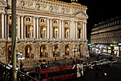 Night time view of Paris, France, Opera House, aglow in lights, and the sourrounding area.