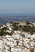 The church on top of the hill is Iglesia de la Encarnacion.Casares is a beautiful tipical white village near Costa del Sol.It seem like a treasure shinning under the strong Andalucian sun.