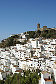 The church on top of the hill is Iglesia de la Encarnacion.Casares is a tipical white village near Costa del Sol. It seem like a treasure shinning under the strong Andalucian sun.