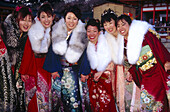 A group of Japanese girls wearing traditional kimono celebrating a coming of age ceremony at Heian-jingu. Kyoto city. Kyoto. Japan.