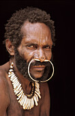 Portrait of a Koroway man wearing a nose adornment made of casoar bones, Western Papuasia, former Irian-jaya, Indonesia