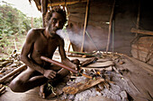 Portrait of a Koroway man smoking, Western Papuasia, former Irian-jaya, Indonesia