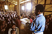 Papuan protestant pastor saying mass in Uldam village, Western Papuasia, Former Irian-Jaya, Indonesia