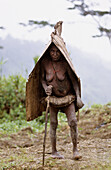 Old Yalis woman wearing rain protection made of bark, Western Papuasia, Former Irian-Jaya, Indonesia