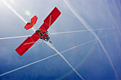 Aircrafts, Blue, Blue sky, Color, Colour, Daytime, Exterior, Flight, Flights, Fly, Flying, Low angle view, Microlight aircraft, Microlights, Outdoor, Outdoors, Outside, Red, Skies, Sky, Transport, Transportation, Transports, Travel, Traveling, Travelling,