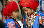 Ethnic red HMong girls from Northern Vietnam are famous for their Yarn-wrapped Big hair. Lai Chau province. Vietnam.
