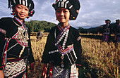 The traditional clothing and headdresses of ethnic Lu girls are highly decorative. Tam Duong. Lai Chau province. Vietnam.