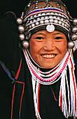 Ethnic Akha women and girls are known for their elaborate silver headdresses. Kengtung. Shan State. Myanmar.