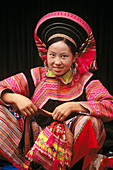 An ethnic flowery Hmong woman in Northern Vietnam. Cau Son. Lao Cai province. Vienam.