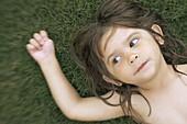 3 year old girl laying on lawn naked, Phoenix, Arizona USA
