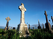 Cemeteries, Cemetery, Color, Colour, Concept, Concepts, Country, Countryside, Cross, Crosses, Crucifix, Crucifixes, Daytime, Death, End, Exterior, Grave, Graves, Graveyard, Graveyards, Outdoor, Outdoors, Outside, Rural, Stone, Tomb, Tombs, World locations