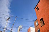 Architecture, Blue, Blue sky, Brick, Bricks, Building, Buildings, Cable, Cables, City, Cloud, Clouds, Color, Colour, Daytime, Exterior, Facade, Façade, Facades, Façades, Horizontal, House, Houses, Low angle view, Orange, Outdoor, Outdoors, Outside, Pole,