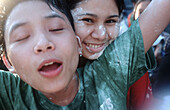 Amusement, Asia, Asian, Asians, Best friends, Child, Childhood, Children, Close friend, Close friends, Close up, Close-up, Closed eyes, Closeup, Color, Colour, Contemporary, Daytime, Ethnic, Ethnicity, Expressive, Expressiveness, Exterior, Face, Faces, Fa