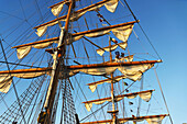 Sailors in the rigging of the Mexican navy training ship Cuauhtemoc at San Diego Harbor, California.