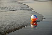 beach ball on ocean shorline