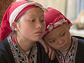 Two red Zao tribe teenagers reflecting. Ta Phin village, Vietnam (april 2006)