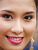 Thai woman smiles for the camera, Candle Festival, Ubon Ratchatani, Thailand.