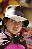 Indigenous girl in cape at Tarabuco market, Bolivia