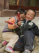 affectionate brother and sister hamming it up, Shangri La, China