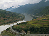 Yangtse River curves past farms and fields before entering Tiger Leaping Gorge, Yunnan, China