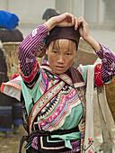 Yi gal carrying her market goods, Yuanyang, China