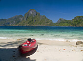 tropical delight, lone kayak on beach opposite Cadlao Island, Bacuit Archipelago, Palawan, Philippines