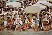Ritual ablutions in Dasashvamedha ghat on Ganges river, Varanasi. Uttar Pradesh, India (October, 2005)