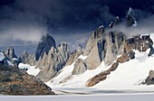 South America, Argentina, Patagonia Parque Nacional los Glaciares Clouds over Cerro Torre and Cerro Fitz Roy
