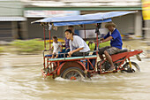 A motorcyclist driving through a flooded street in Sukhothai. Torrential rains over the past few weeks have resulted in major floodings in most of northern Thailand, with the Uttaradit and Sukhothai areas being most affected