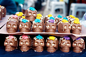 Chocolate skulls. Mexican tradition in All Saints Day, devoted to remembering the dead, is to offer sweet skulls with their names on. Mexico.