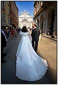 Adult, Adults, Back view, Bridal couple, Bride, Bridegroom, Bridegrooms, Brides, Celebrate, Celebrating, Celebration, Celebrations, Ceremonies, Ceremony, Church, Churches, Color, Colour, Contemporary, Couple, Couples, Daytime, Dress, Dressed up, Dresses,