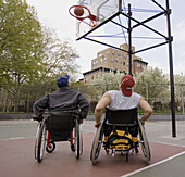 Ability, Activity, Adult, Adults, Amusement, Ball, Balls, Basketball, Color, Colour, Compete, Competing, Competition, Competitions, Contemporary, Court, Courts, Daytime, Disability, Disabled, Exterior, Full-body, Full-length, Fun, Game, Games, Handicap, H