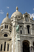 Basilique Du Sacre Coeur in Montmartre is one of the most recognizable landmarks on the skyline of Paris. Construction began in 1873 and the basilica consecrated in 1919.  2005. Paris. France.
