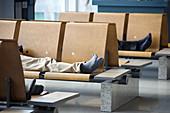 Men sleeping at airport, Incheon International Airport, South Korea