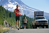 Participants, runners on Highway 26, Mount Hood to coast relay race, Hood to Coast, Oregon, USA