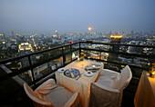 Vertigo Restaurant, Rooftop outdoor restaurant in Sukhothai Hotel overlooking Bangkok, Thailand
