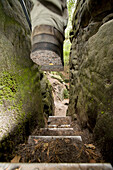 Hicker on staircase between rocks, Elbe Sandstone Mountains, Saxon Switzerland, Saxony, Germany