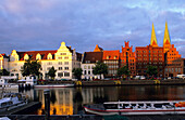 Houses at Holsten harbour with St. Mary's church in the light of the evening sun, Luebeck, Schleswig Holstein, Germany, Europe