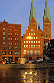 Gabled houses and St. Mary's Church in the light of the evening sun, Luebeck, Schleswig Holstein, Germany, Europe